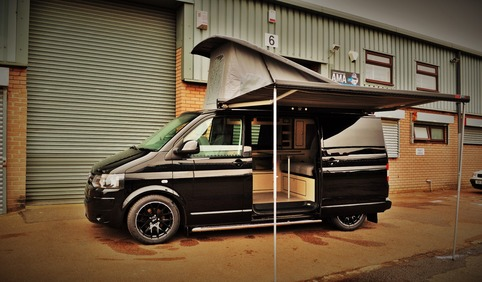 With Fiamma F45s awning and Austop Elevating roof.
